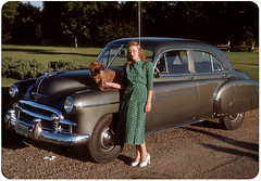 Lady with car and dog (kevin63) Tags: lightner photo woman car vintage antique old dog fifties california forties green dress spaniel white shoes kodachrome film labor day