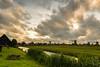A cluster of old Dutch mills. (Alex-de-Haas) Tags: dutch holland hollandseluchten nederland netherlands noordholland zaanseschans clouds gras grass grasslands landscape landschap meadow meadows oerhollands skies sky summer sunny weiland weilanden wolken zomer zonnig