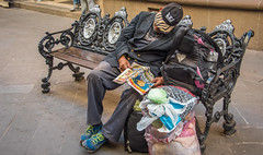2016 - Mexico - San Luis Potosi - Siesta (Ted's photos - Returns late December) Tags: 2016 cropped mexico nikon nikond750 nikonfx sanluispotosi tedmcgrath tedsphotos tedsphotosmexico vignetting bench seating seated sitting seat sleeping newspaper ballcap backpack streetscene street curb sidewalk slp people