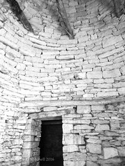 Double caselle interior doorway (AJ Mitchell) Tags: door doorway passage passageway link stone caselle lot quercy bw blackandwhite beams dark