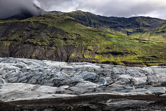 Skaftafell (Sergey Alimov) Tags: mountain snow mountains green ice landscape iceland cloudy glacier dirt precipice sland skaftafell rfajkull hvannadalshnkur