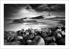 DUNSTANBURGH (SwaloPhoto) Tags: england bw castle zeiss canon bay coast rocks availablelight cliffs northumberland coastal le northsea ze hightide topaz dunstanburgh englishheritage bythesea embleton leefilters distagont2821 eos5dmkii bigstopper distagon2128ze bweffects2