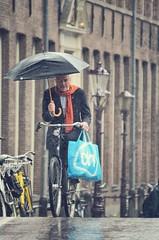 Precipitation (Amsterdamize) Tags: city summer people netherlands rain amsterdam bike bicycle umbrella cycling citylife bikes bicycles regen fietsen fiets urbancycling citycycling peopleonbicycles peopleonbikes amsterdamize bikeams