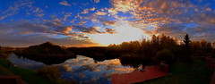 Pano: Sunset reflections on Bluebird Estates (peggyhr) Tags: blue trees sunset sky panorama orange brown sun white lake canada green clouds standing reflections dock pano hills alberta thegalaxy 50fave