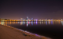 Perth by Night (ajc--photography) Tags: city longexposure nightphotography travel beach water night skyscraper reflections river stars star evening still sand cityscape skyscrapers riverside sigma australia wideangle calm perth slowshutter wa 1020mm westernaustralia swanriver foreshore southperth travelphotography sigma1020 southperthforeshore