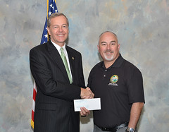 Rep. Matt Hudson presenting a check to Collier County Sheriff Kevin Rambosk to support the Junior Deputy Program