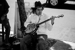 Banjo (Jmaphotoblog) Tags: street portrait blackandwhite musician man folk banjo blues soul passion streetperformer strings tambourine soulful oldtimey twangy pluckingthosestrings