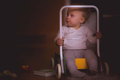 Sitting in the walker (njumjum) Tags: world travel light portrait baby playing cute love girl beauty smile face fairytale children wonder real happy golden kid moments shadows child natural little action expression unique candid exploring magic small stock lifestyle happiness naturallight story babygirl learning mf moment crawling manualfocus learn wonders parenting milestones fail succeed discovering girlhood beforedark naturalmoment stockphotographer sonya7 availablestockimage