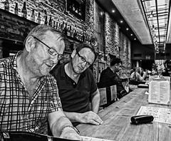 Choosing a beer ( 2nd Night - Beer'Ligale Craft Beer Bar) (Gritty BS Effect) Panasonic Lumix DMC-LX100 Compact (markdbaynham) Tags: group people barcelona panasonic dmclx100 lx100 compact 2475mm f1728
