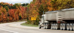 One Mile To Go... (Wes Iversen) Tags: htt happytruckthursday leelanaupeninsula michigan nikkor18300mm traversecity autumn autumncolor highways motion motionblur roadsigns roads signs trees trucks