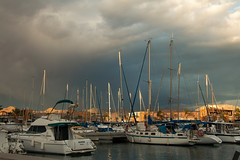 Bad weather coming (han350d) Tags: weather clouds sky harbour puertodemazarrn murcia spain boats canoneos400d sigma18250 tan sailboats waterfront skyline x6