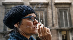 Smoke. (Baz 120) Tags: candid candidstreet candidportrait city candidface candidphotography contrast colour street streetphoto streetcandid streetphotography streetphotograph streetportrait streetfaces rome roma romepeople romecandid romestreets europe urban voigtlandercolorskopar21mmf40 life leicam8 leica primelens portrait people unposed italy italia grittystreetphotography flashstreetphotography flash faces decisivemoment strangers