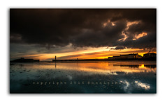 Ice and a Slice Anyone? (RonnieLMills) Tags: donaghadee harbor harbour lighthouse sunrise dawn early morning dark clouds autofocus greatphotographers