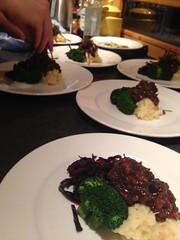 Evie serving up our Ox Cheek stew with celeriac mash, braised spiced cabbage and tarragon butter tossed broccoli.