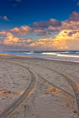 Tracks On The Beach (k009034) Tags: 500px waves australia copy space gold coast queensland tranquil scene beach clouds evening nature no people ocean oceania sand sea sky sunset tracks travel destinations water teamcanon