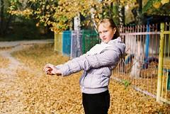 during a walk (Guy Fawkes Jr.) Tags: autumn portrait girl leaves analog pretty asahi bokeh outdoor naturallight negative scanned pentaxmesuper classiccamera c41 fujisuperia100 135film smcpentaxm50mmf17 manualfocuslenses morethan10yearsexpired