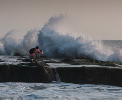 """Braving the waves at Tanah Lot Bali • <a style=""""font-size:0.8em;"""" href=""""http://www.flickr.com/photos/7605906@N04/14986133874/"""" target=""""_blank"""">View on Flickr</a>"""