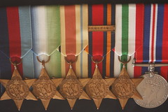 Royal British Navy WWII Medals (behind glass) 1 (Inquisitive Eye) Tags: silver gold war wwii ribbon tabletop medals lestweforget behindglass britishroyalnavy wwiimedals