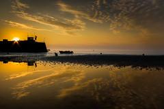 Gorey Harbour sunrise (snowyturner) Tags: morning sea sky reflections boats pier harbour jersey channelislands gorey