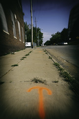 INFINITY IS JUST AROUND THE CORNER (akahawkeyefan) Tags: sky brick weeds sidewalk arrows desmoines davemeyer flourescentpaint