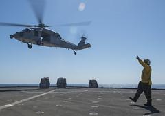 USS Makin Island (LHD 8)_141009-N-CU914-162 (U.S. Naval Forces Central Command/U.S. Fifth Fleet) Tags: ocean west island bahrain san war gulf pacific indian group navy diego lenny hong kong transit malaysia terror marines arabian dod fleet lacrosse arg 5th 7th isis uss osprey platforms amphibious makin comstock isil readiness departmentofdefense mv22 hooyah lsd45 lhd8 cu914 npase lpd22 presencematters phibronfive