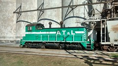 Austin Todd and Ladd (ATLT) switcher 1127 at the big elevator in Watonga, OK (LnCS) Tags: railroad oklahoma hill rr ok railfan watonga curtis chr 2014 atlt
