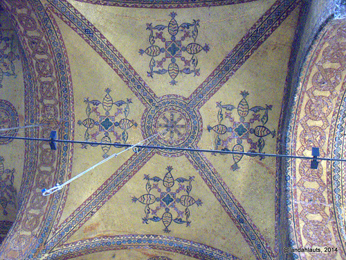 Ceiling decoration showing original Christian cross still visible through the later aniconic decoration