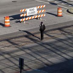 end of the road (weltreisender2000) Tags: solitary man pedestrian orange hazard sign street rail sunlight shadow memphis tennessee