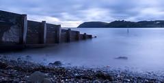 (leighbeta) Tags: sea water beach ocean estuary river sand stones pebbles castle wales carmarthenshire llansteffan ferryside longexposure grey blue canon 500d sunset twilight dusk sky clouds