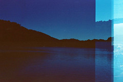 Serene (Tamar Burduli) Tags: landscape nature waterscape travel analog film lake mountains forest island croatia doubleexposure multipleexposure tamarburduli blue beach