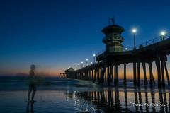 Ghost surfer (sixpakaar) Tags: huntington beach blue light silhouette ghost pier sunset shadow water ocean sand nikon art orange california