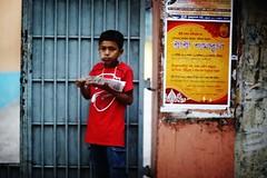 Look before you eat.... (N A Y E E M) Tags: boy red snack candid portrait afternoon street chatteshwariroad chittagong bangladesh carwindow