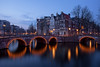 the world is still beautiful (s.f.p.) Tags: keizersgracht leidsegracht amsterdam holland netherlands nederland bridge canal amstel long exposure sunset night buildings cross point lights winter cityscape europe travel postcard