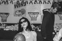 Woman shooting basketball backwards at San Gennaro (L A Nolan) Tags: 35mm 35mmf2 50mmequiv fuji fujifilm fujifilmxpro2 fujinon fujinonxf35mmf2 littleitaly manhattan newyork newyorkcity newyorknewyork night ny nyc outdoors outside people sangennaro streetphotography thebigapple xpro2