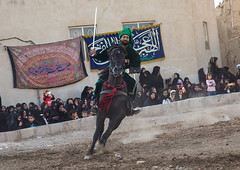 Man riding a horse during a traditional religious theatre called tazieh about imam hussein death in kerbala, Isfahan province, Isfahan, Iran (Eric Lafforgue) Tags: 9people artscultureandentertainment ashura battle ceremony clothing colorimage commemoration condolencetheater drama epic esfahan fullframe fulllength groupofpeople historicalreenactment history horizontal horse imamhussein iran iranian isfahan islam ispahan knight men middleeast mourning muharram muslim outdoors periodcostume persia photography play religion religiouscelebration shia shiism shiite tazieh theatre women isfahanprovince