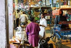 Chit chat with a friend on a busy night (Old Delhi) (hacenem) Tags: bazar olddelhi delhi india