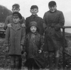 Cold & wet (theirhistory) Tags: boys children kids raincoat coat cap waterproof souwester wind rain seaside hat