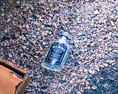 Empty Jack (adh1204) Tags: jackdaniels discarded cityscene drunk