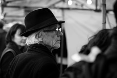 Just Browsing, Thanks. (billygibbon05) Tags: amsterdam street photo leica portrait hat browsing monochrome black white 135mm sony a7ii