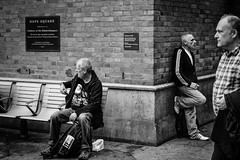 Hope Square (http://thomasthorstensson.photography) Tags: life street camera city autumn people urban black london film monochrome station weather composition buildings bench season print square photography layout town photo construction october waiting day shot bright image time centre thinker picture plate sunny fair structure formation clear n