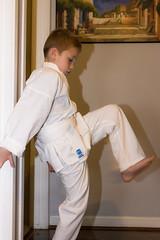 Practicing His Kicks (Michael Bentley) Tags: andrew karate gi whitebelt speedlite canonef35mmf14lusm 3652014 2014yip