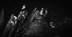 Through the Ruins ([the dvrkroom.]) Tags: friends blackandwhite abandoned film analog 35mm dark ruins pentax adventure urbanexploration mysterious pentaxk1000 lincolnpark filmgrain abandonedamusementpark southdartmouthma