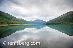 Lake Eklutna near Anchorage Alaska (Remsberg Photos) Tags: usa lake cold reflection nature water beauty alaska landscape outdoors freedom fantastic worship day quiet peace escape looking respect natural opposite earth altitude religion colorphotography scenic floating tranquility peak away nopeople adventure explore silence serenity remote concept wilderness dawning relaxation awe exploration majestic moveon idyllic isolated exposed digitalimage intimidating removed openness forwards admiration naturalphenomenon inthedistance lakeeklutna faroff beautyinnature coldtemperature moveforward cloudysnowcap movetowards