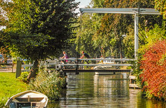 23-Cyclists still able to cycle over draw bridge with boats waiting in Broek in Waterland -2-  25Sep16 (1 of 1) (md2399photos) Tags: broekinwaterland hollandholiday25sep16 irenehoevetouristshop monnickendam