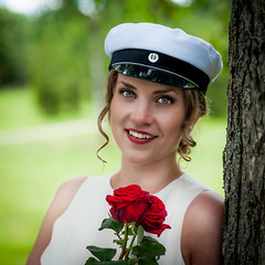 Just graduated (madmtbmax) Tags: people portrait graduated student young girl woman female donna kvinna frau outdoor sommer square white cap red rose sensual beauty beautiful smile bright eyes look bokeh model youth tree finnland finland ylioppilas yojuhlat summer suomi