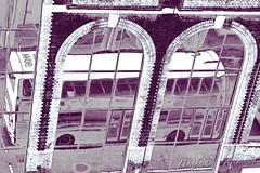 Near Waterloo station... (The world in f stops) Tags: bus monochrome london england uk waterloo transport traffic reflexion building windows arches bricks citycanon