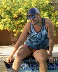 IMG_0263 (danimaniacs) Tags: party man guy sexy hot hiary beard scruff mansolo trunks bathingsuit smile tanktop hat cap