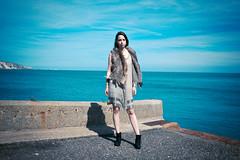 Dock-Side (Eugene Patrick) Tags: lightroom canon60d docks boots fashion girl blue sky concrete fur dress