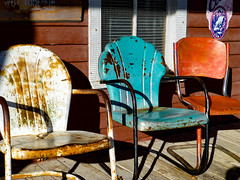 3 Old Empty chairs (plethora4834) Tags: chairs old empty available three 3 aladdinwy wyoming generalstore aladdingeneralstore frontporch porch white aqua red rust rusty