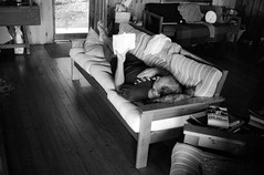 Reading Material (george.bremer) Tags: 352nikkoro 5222 bw books cabin caffenolcl couch eastmandoublex epson f3 f3hp film kodak nikon reading relaxing scan summer v750